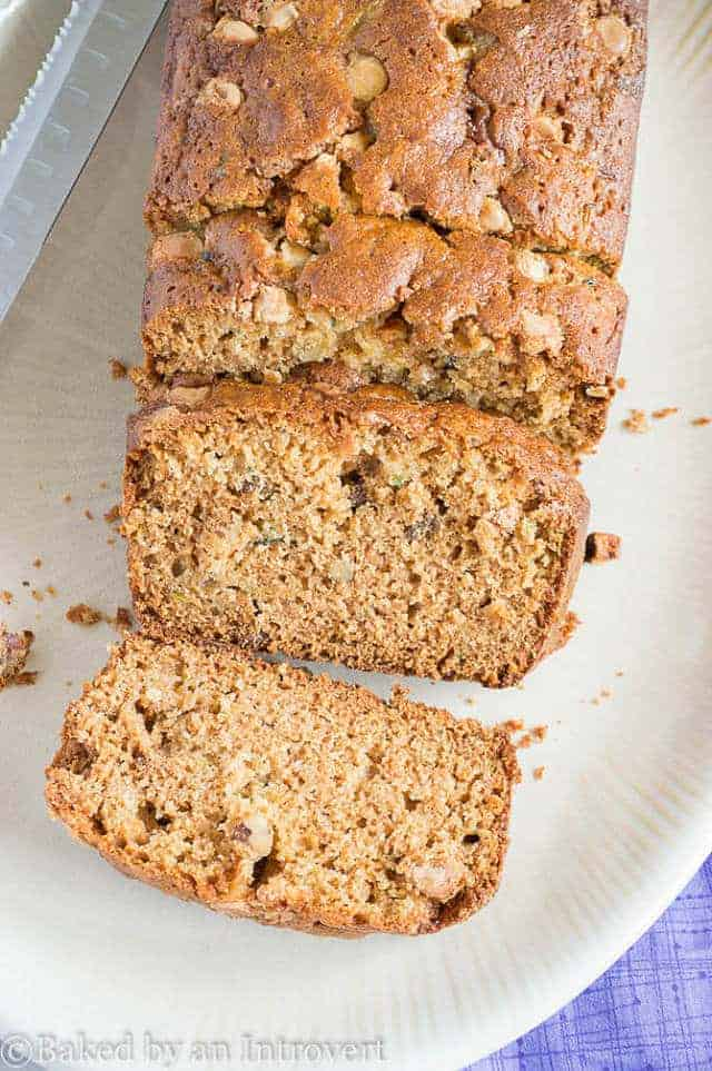 overhead of honey nut zucchini bread with three slices cut