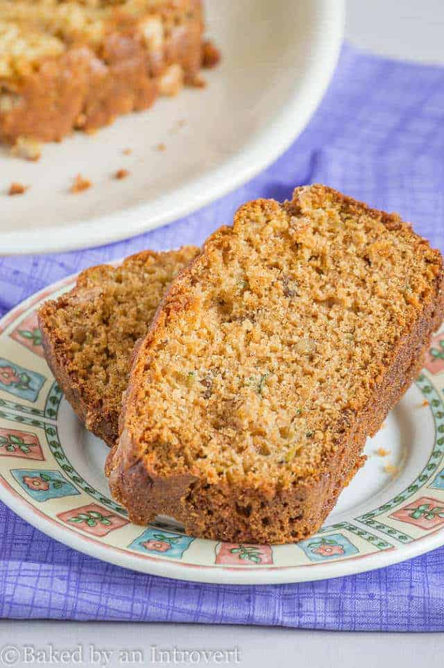 close up of two slices of zucchini bread on plate