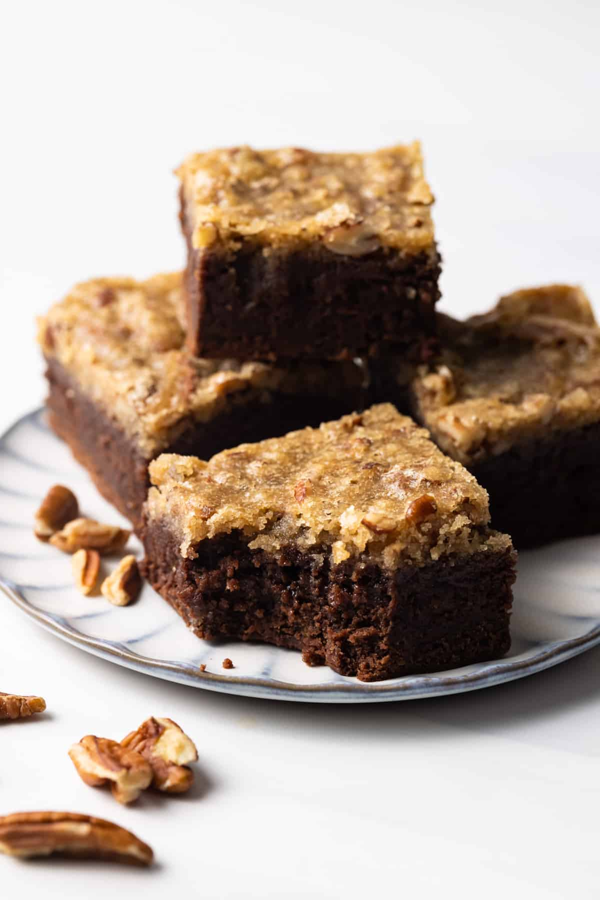 Four pecan pie brownies on a plate
