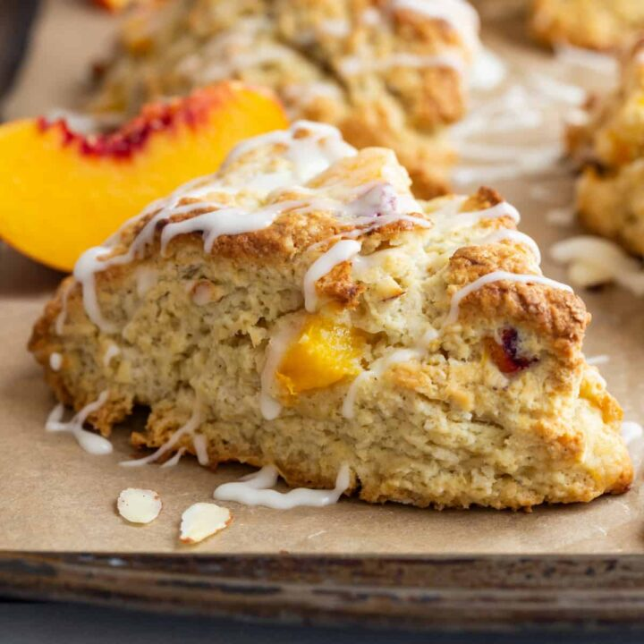 side view of peach scones on a baking sheet