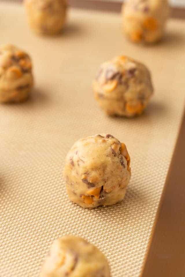 butterscotch toffee cookie dough balls on a baking sheet