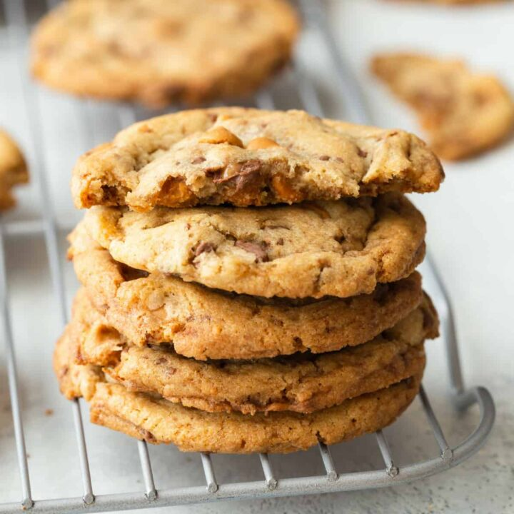 butterscotch toffee cookies stacked on a wire rack
