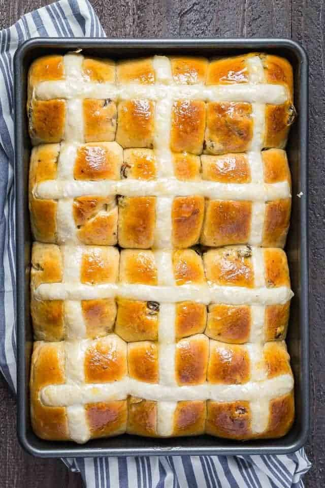 overhead view of hot cross buns in a pan