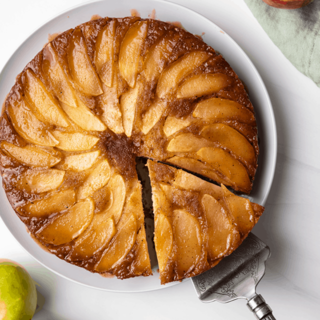 Spiced apple upside down cake with slice being pulled away.
