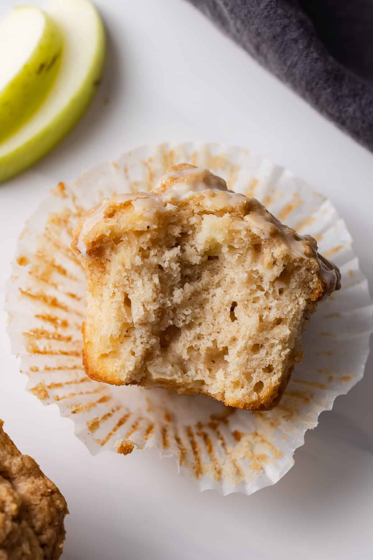 An apple streusel muffin with a bite missing