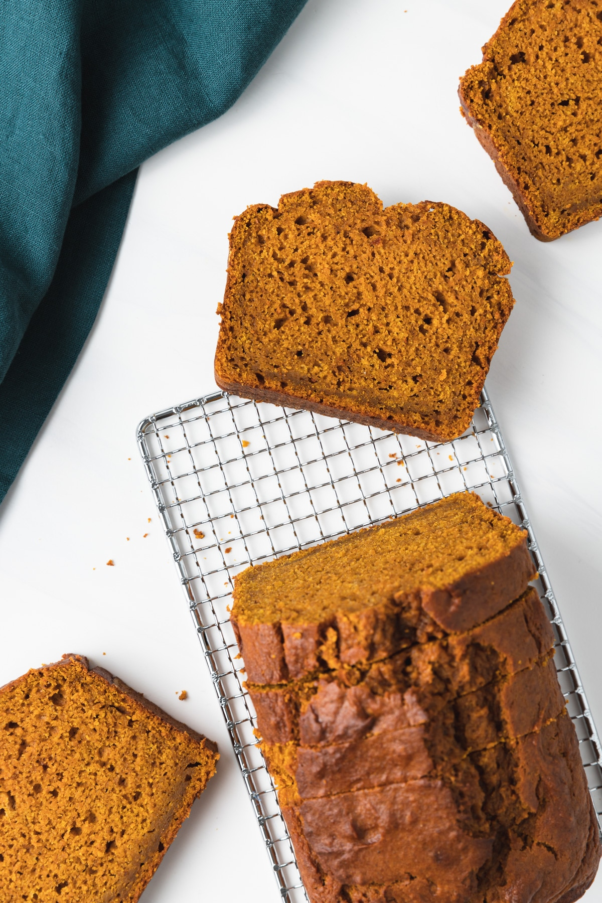overhead of pumpkin bread with slices taken out