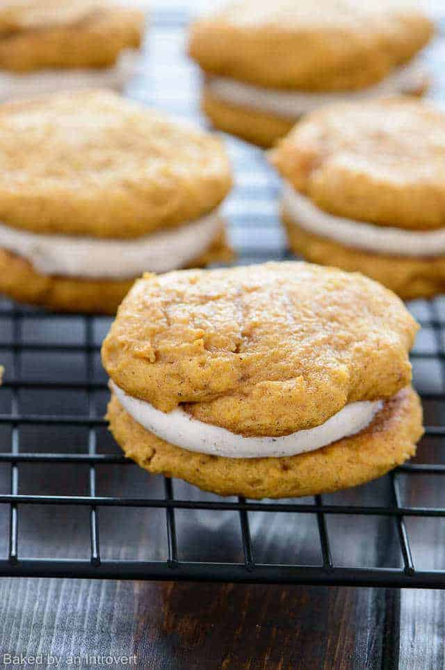 Enjoy soft, lightly spiced pumpkin whoopie pies filled with a decadent, cinnamon cream cheese frosting!