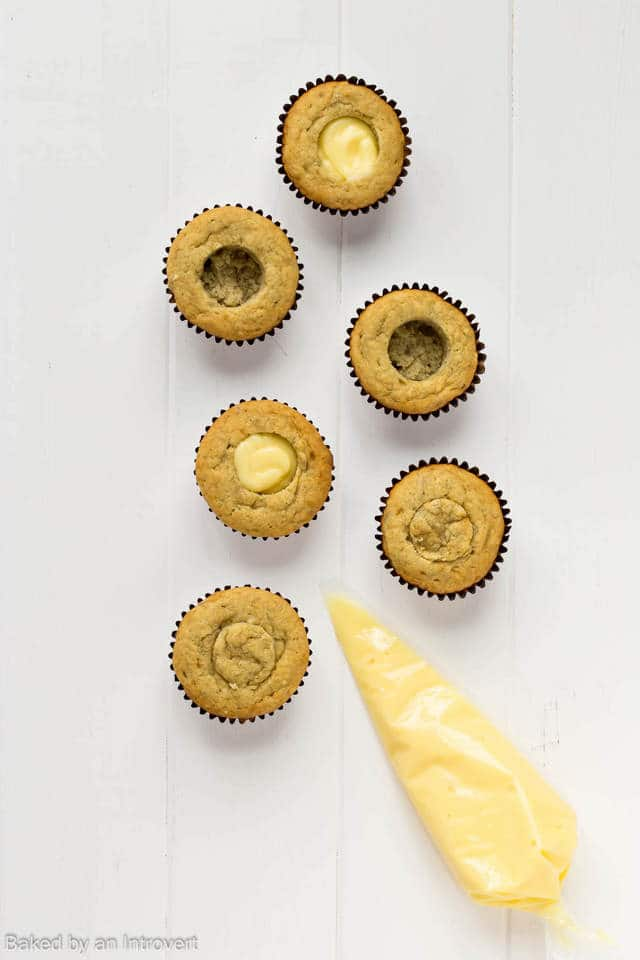 Banana cupcakes filled with vanilla pudding.