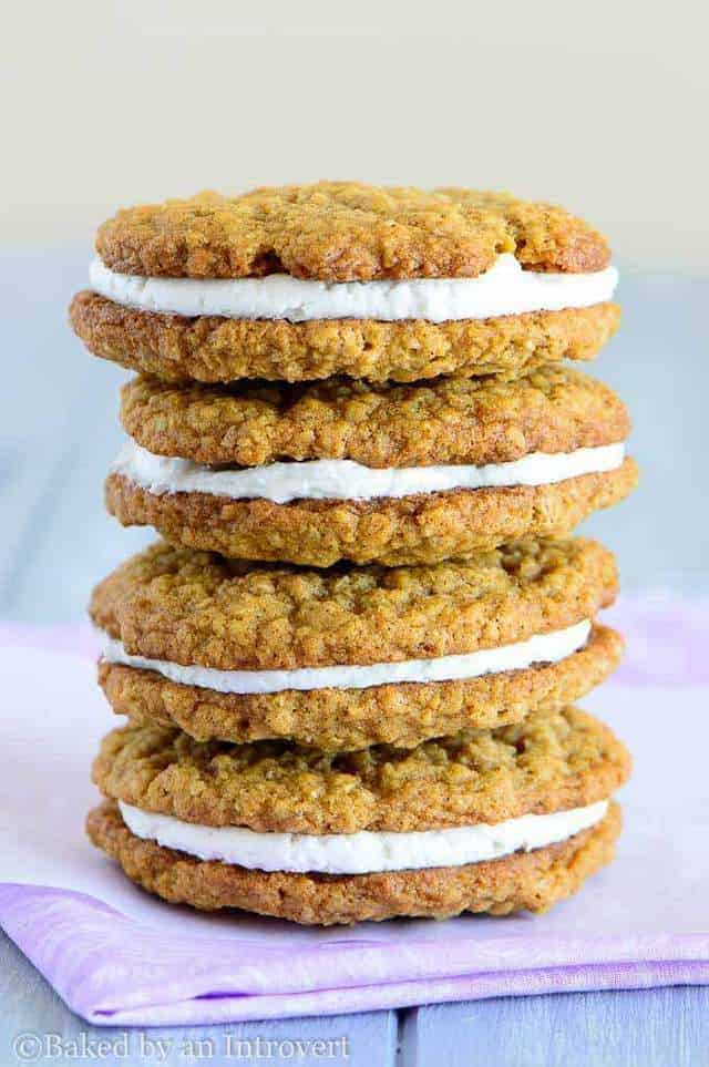 Four oatmeal cream pies stacked on a purple napkin