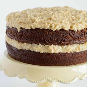 This recipe for German Chocolate Banana Cake features the traditional light chocolate cake with a coconut-banana filling.