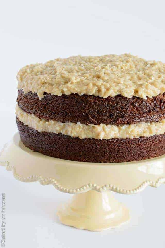 German chocolate banana cake on a yellow cake stand