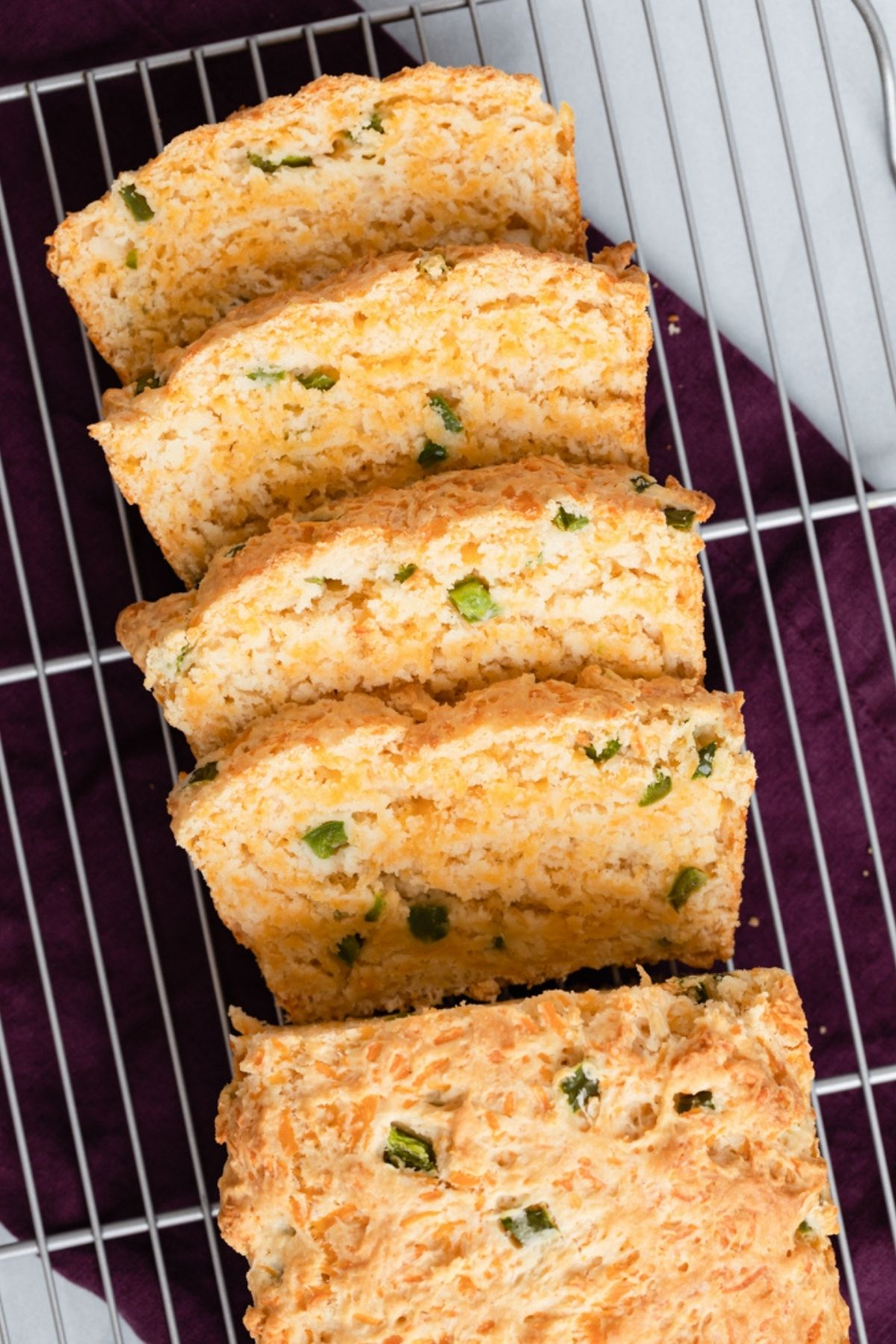Angled view sliced cheddar jalapeno buttermilk bread.