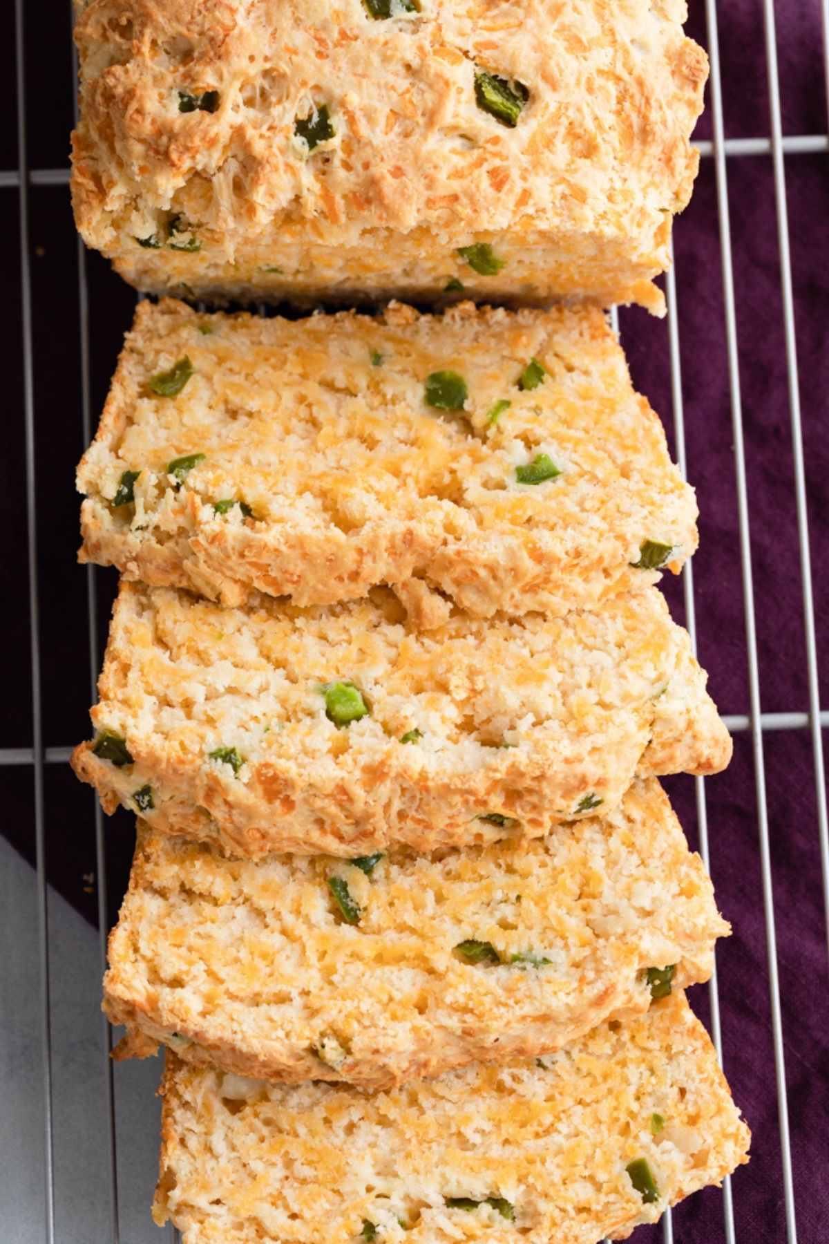 Close up view of slices of cheddar jalapeno buttermilk bread