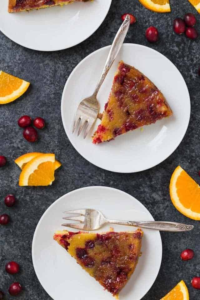 2 slices of Cranberry Orange Upside Down Cake on plates.