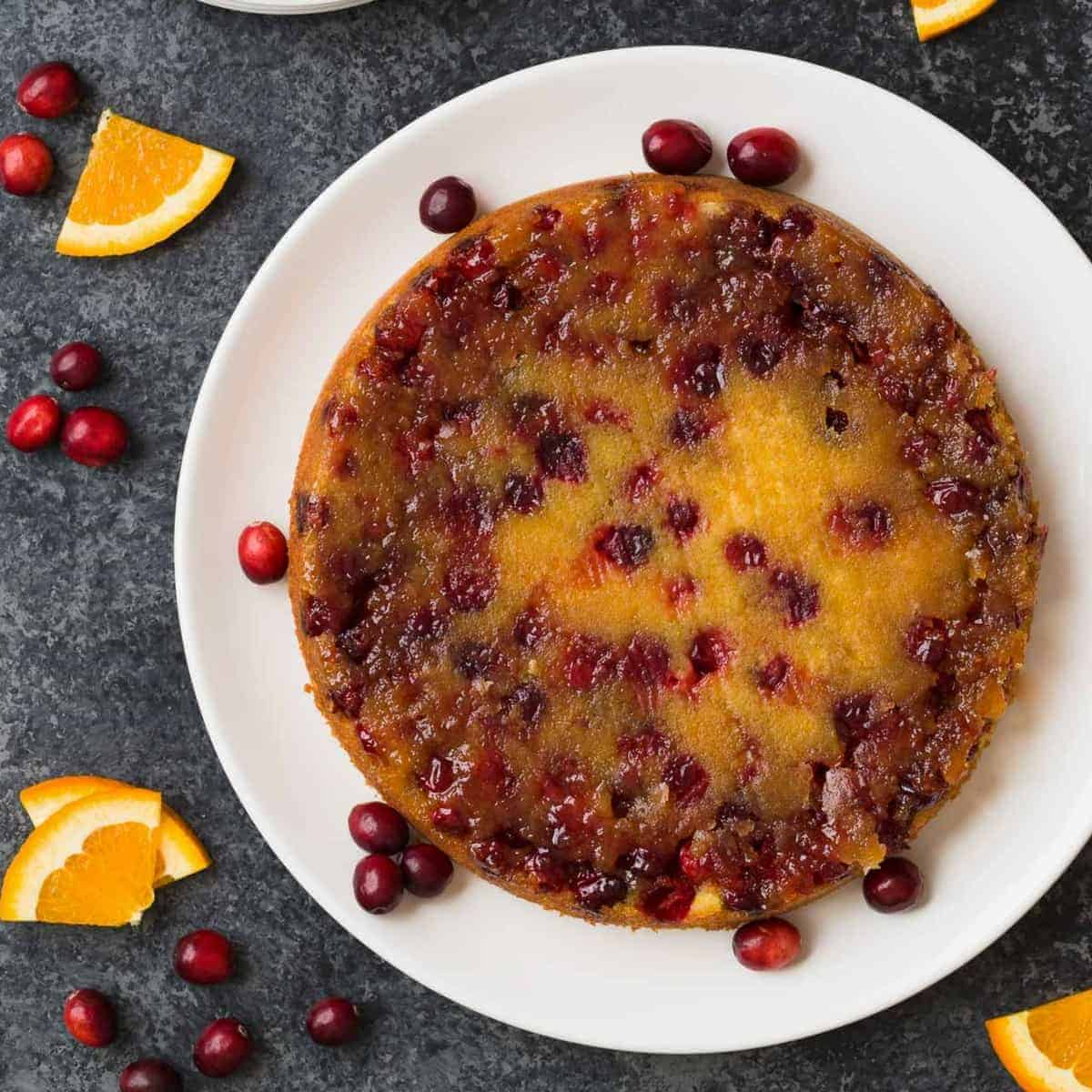 Inverted Cranberry Orange Upside Down Cake on a serving plate.