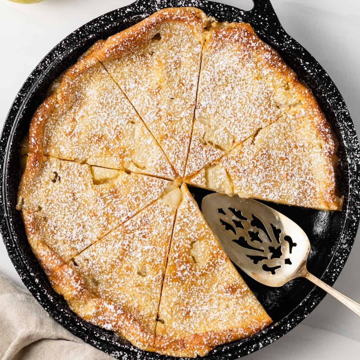 overhead view of Maple Pear Clafoutis in a cast iron skillet