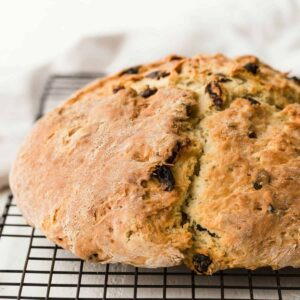 This Irish Soda Bread is a family favorite. It has a crunchy exterior while the inside is soft and buttery. It's flavored with fragrant caraway seeds and plump dark raisins. And there's a slight sweetness.