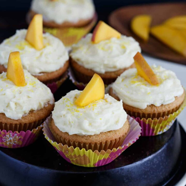 Mango cupcakes arranged on an upside-down cake pan.