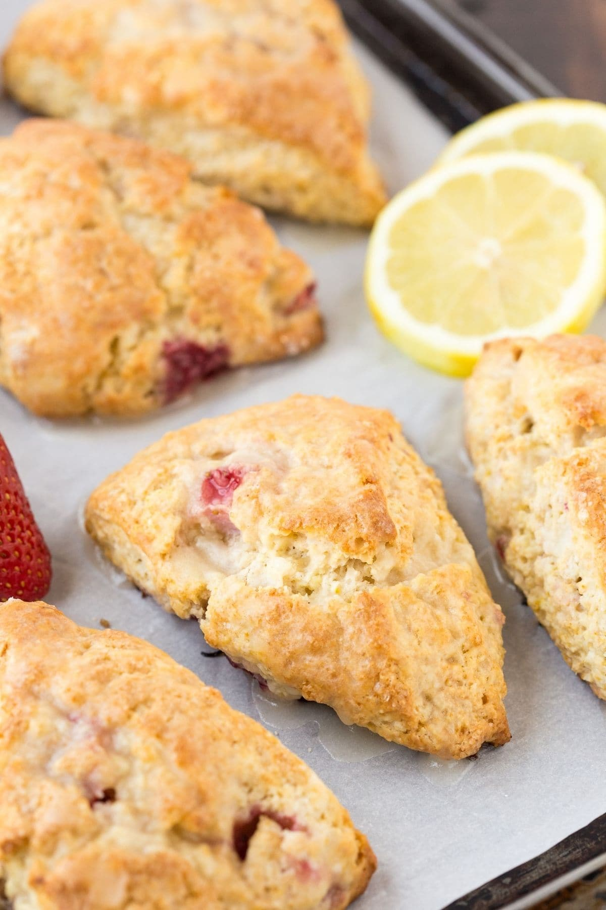 Lemon Cream Cheese Scones on a baking sheet lined with white parchment paper.