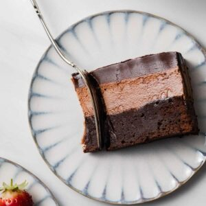 Triple chocolate Mousse Cake made with a chocolate cake base, cool creamy mousse filling and topped with rich dark chocolate ganache.