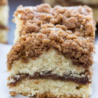 Cinnamon Crumb Coffee Cake with a thick cinnamon streusel topping over fluffy, buttery cake, and a ribbon of melty cinnamon in the center.