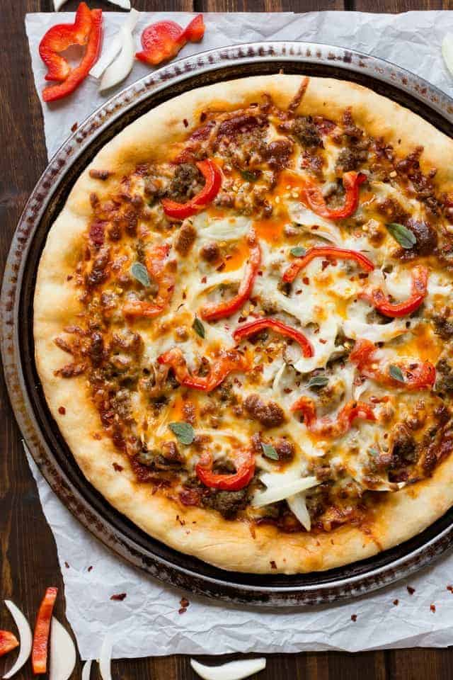 Spicy Sausage Pizza on a round pizza pan.