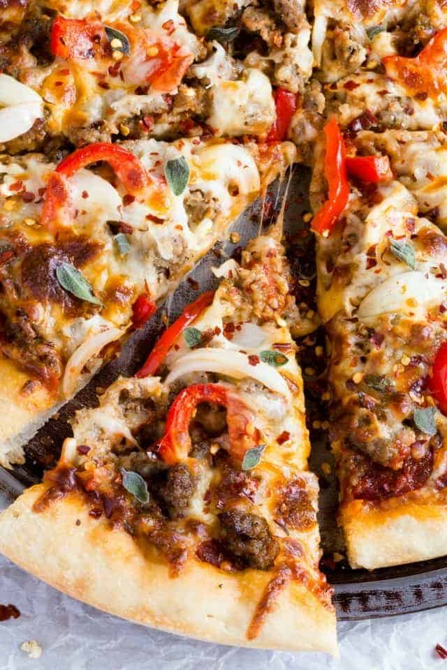 Up close view of a slice of spicy sausage pizza.