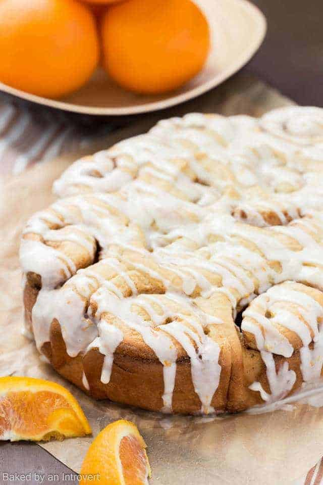 Slow Cooker Orange Sweet Rolls on brown paper
