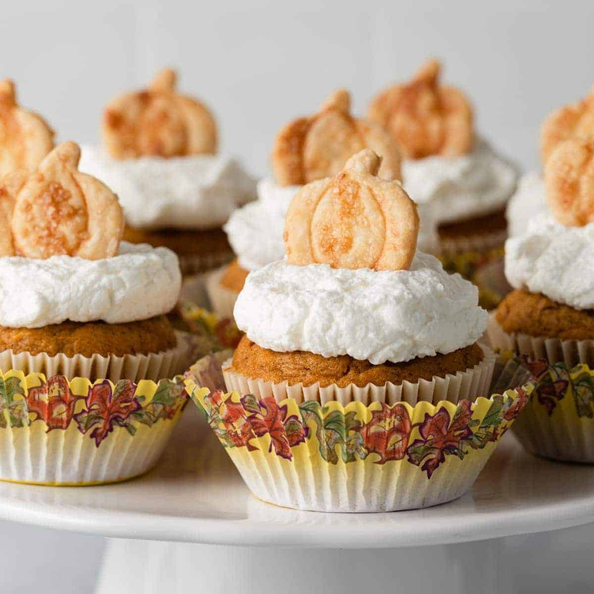 pumpkin pie cupcakes on a white cake stand