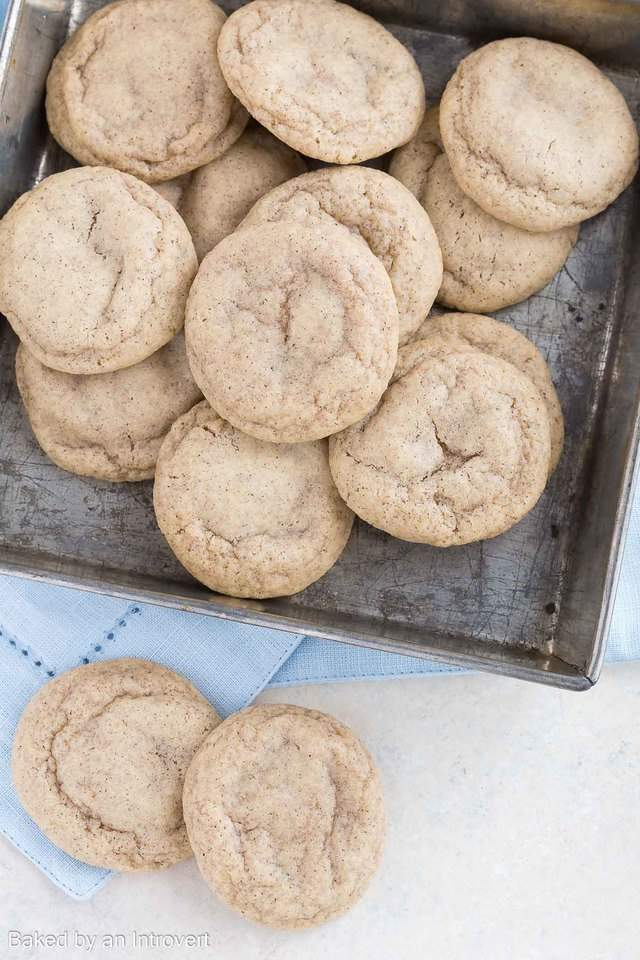 Overhead view of Chai Cookies in a pan and on a blue fabric.