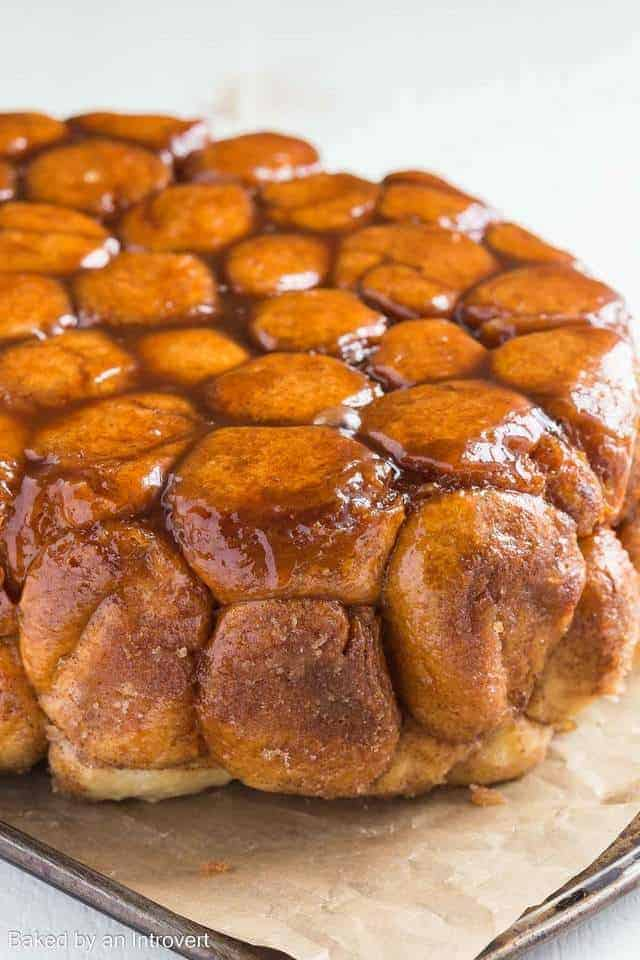 Slow Cooker Monkey Bread on a baking sheet lined with brown parchment paper.