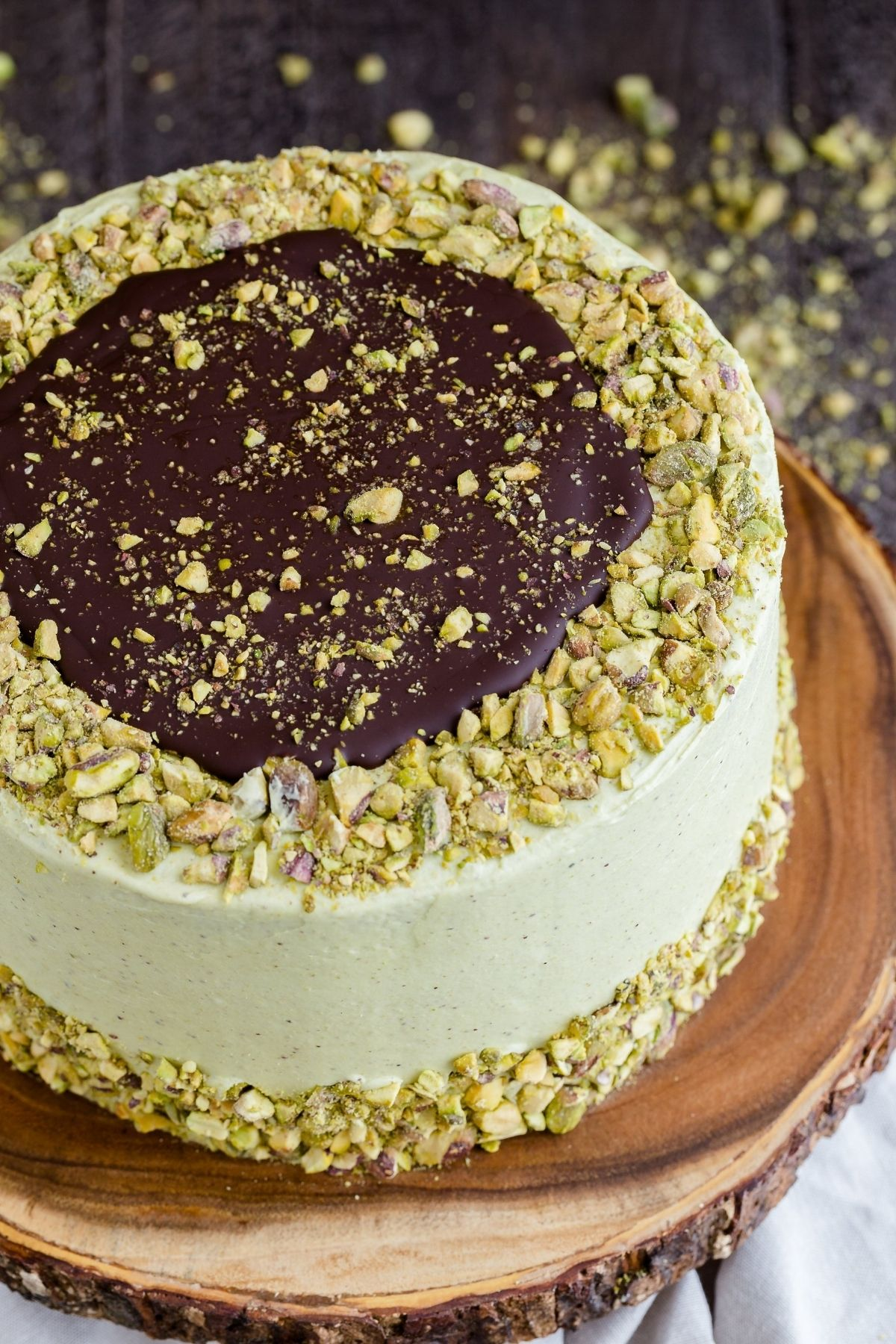 This layered Chocolate Pistachio Cake will turn heads! Rich decadent chocolate cake slathered in light, creamy pistachio frosting. It looks just as good as it tastes.