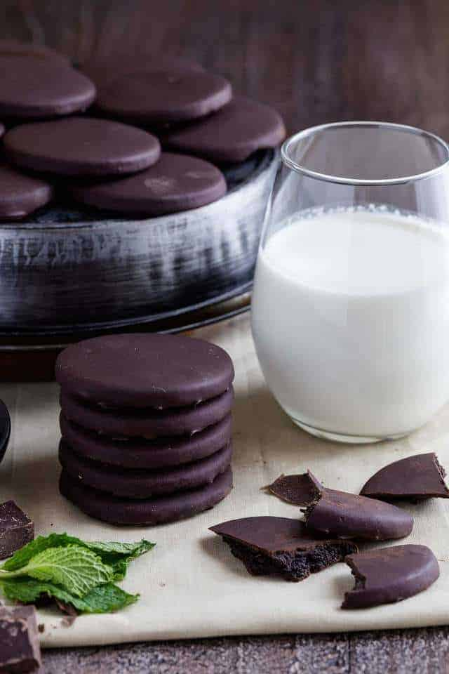 A stack of homemade thin mints and a glass of milk.