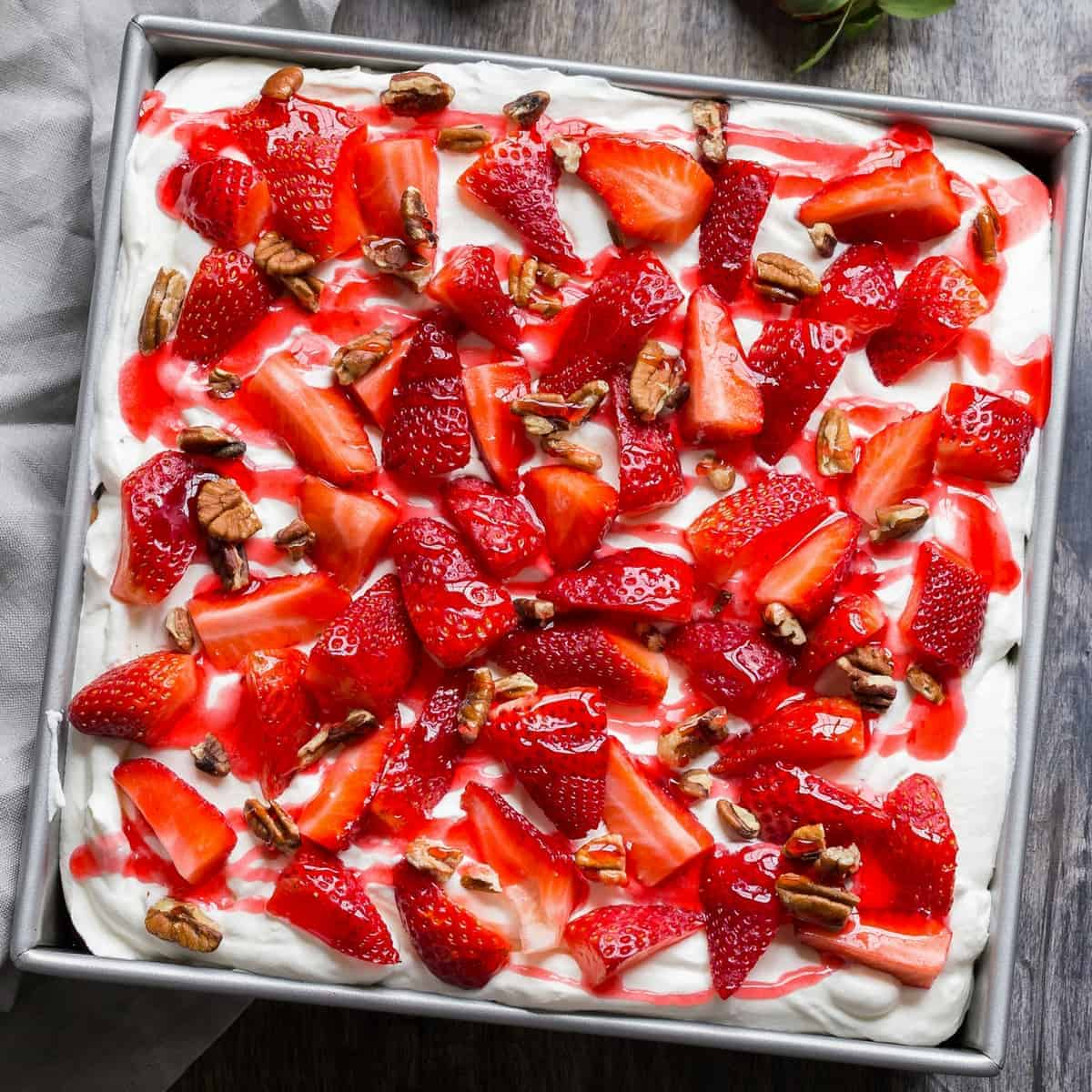 overhead view of Strawberries and Cream Icebox Cake in a square pan