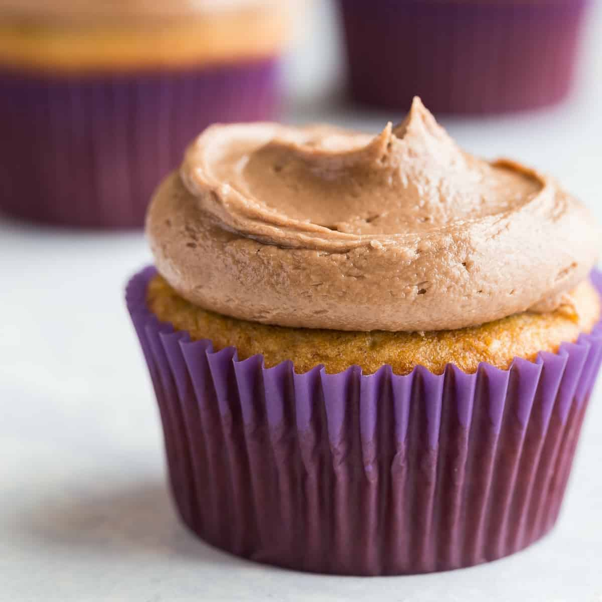 swirls of Nutella frosting over banana cupcakes