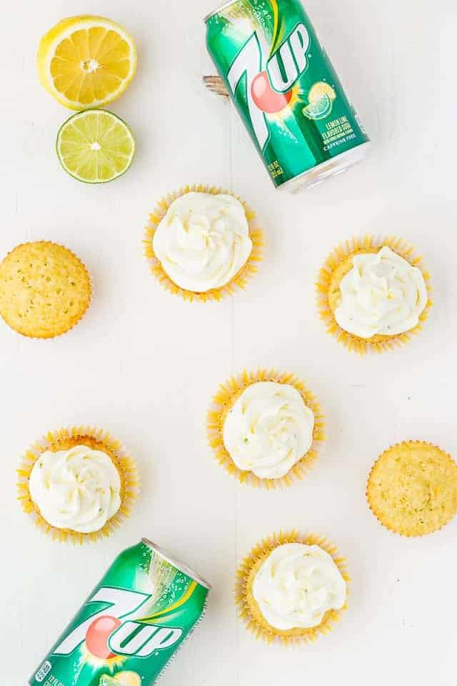 Overhead view of lemon lime cupcakes and cans of 7UP.