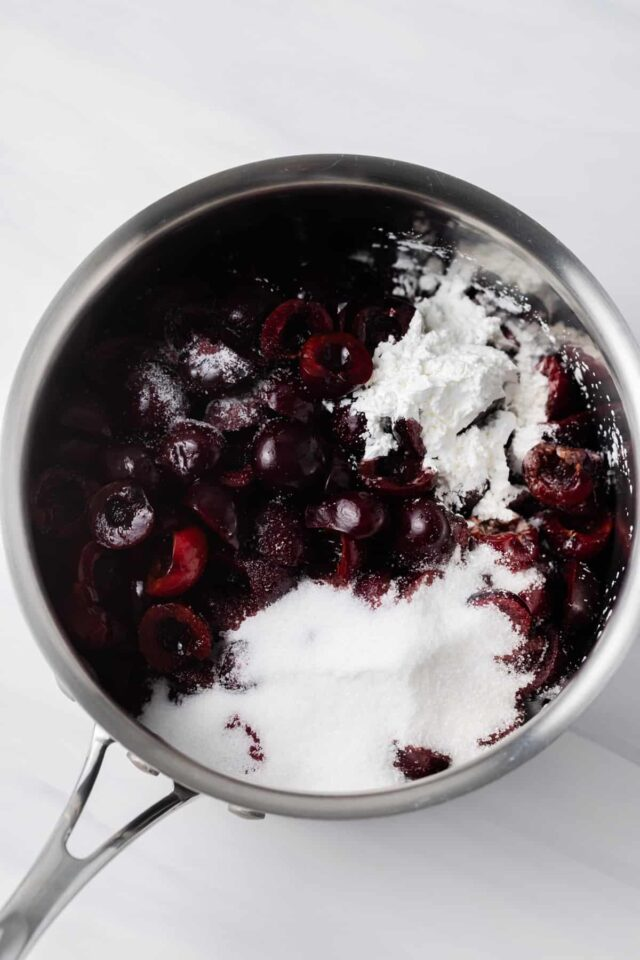 Halves cherries with sugar and cornstarch in a pan