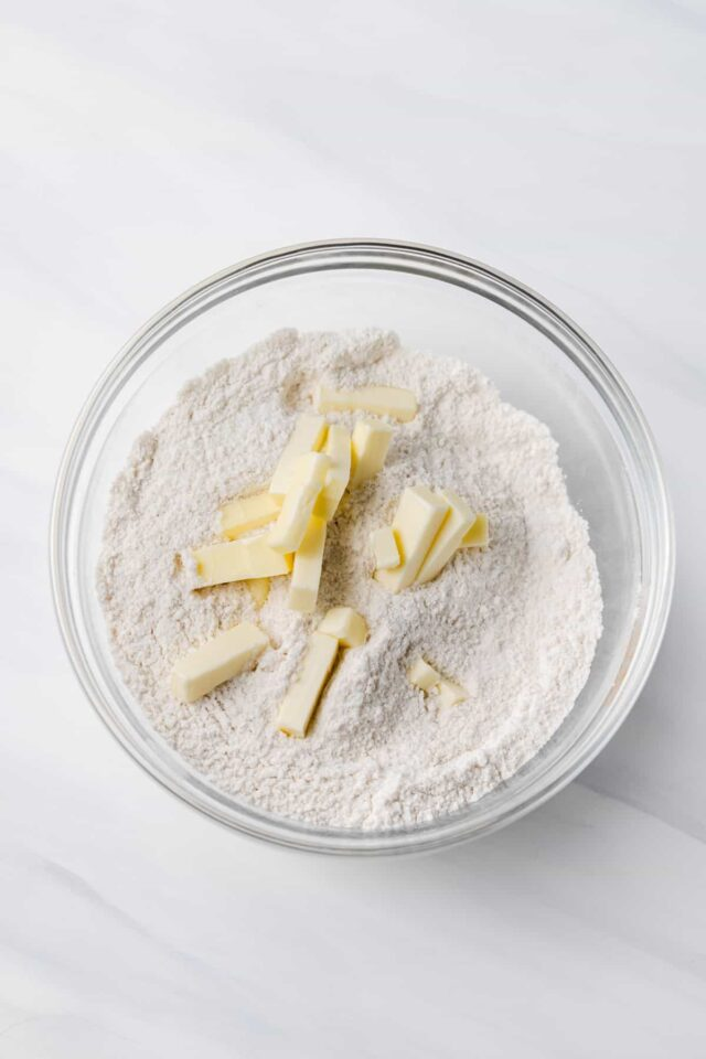 Cold butter in a bowl with dry ingredients