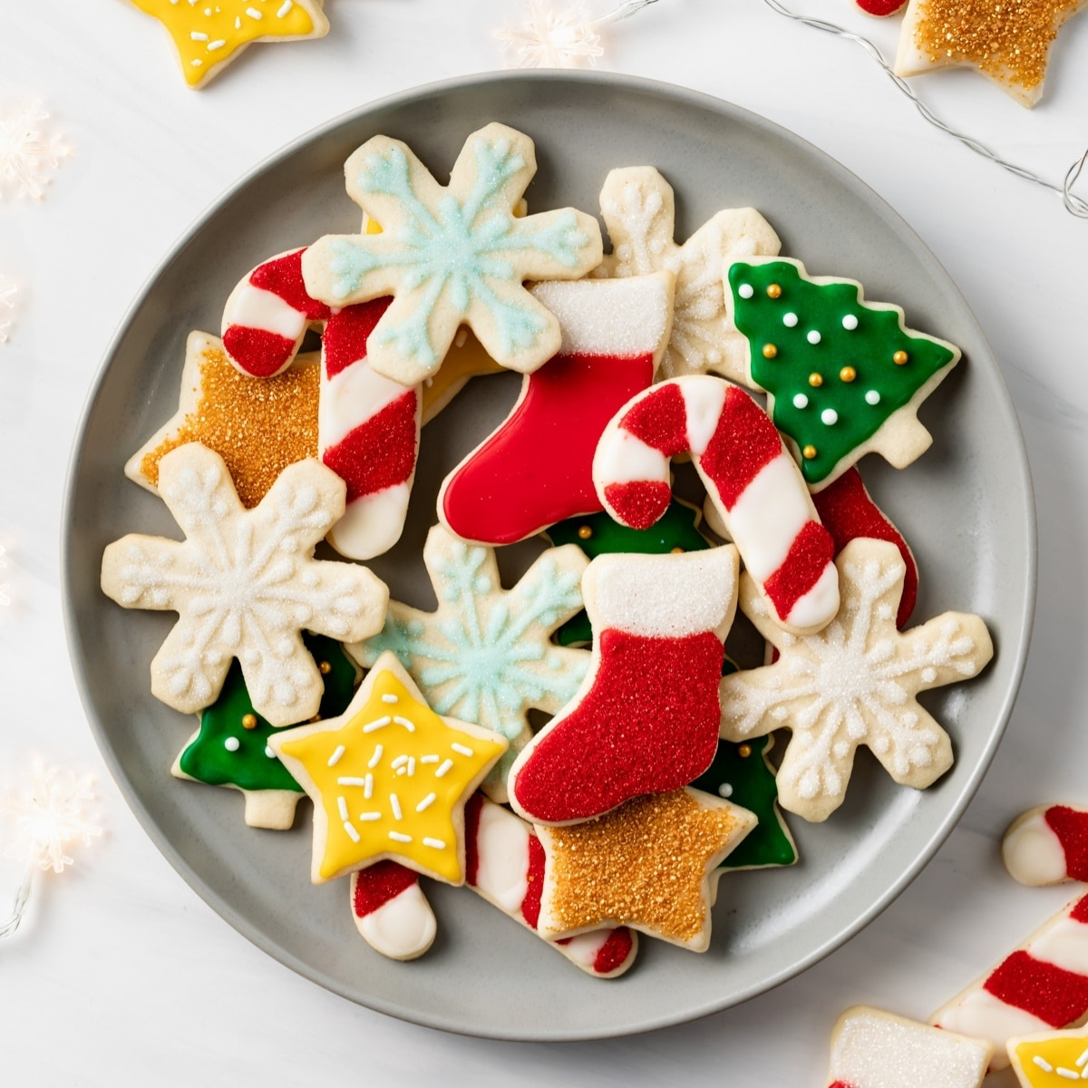 decorated sugar cookies on grey plate