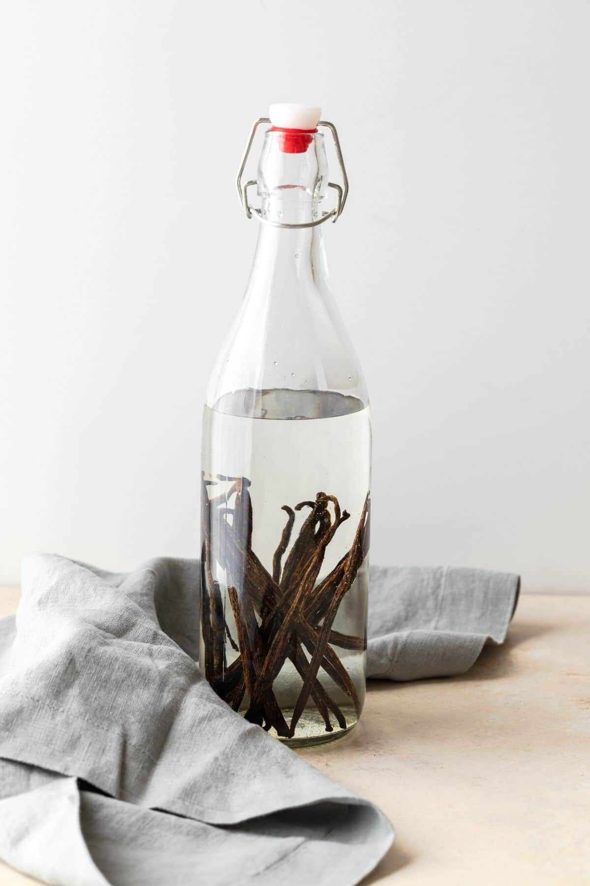 vanilla beans in a clear jar of vodka