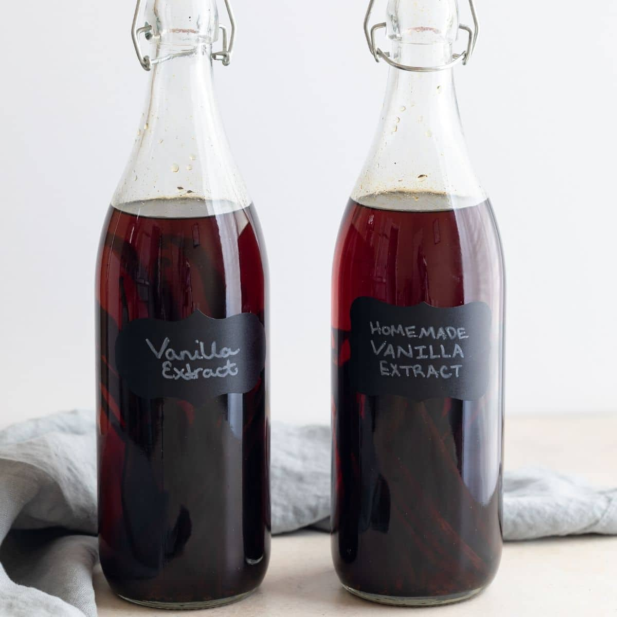 homemade vanilla extract in clear glass jars