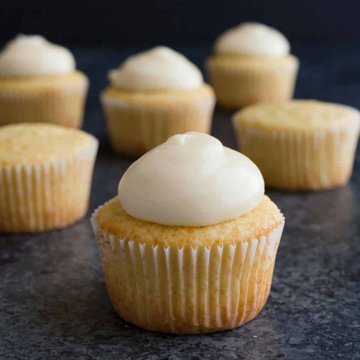 Lemon cream cheese frosting over cupcakes.