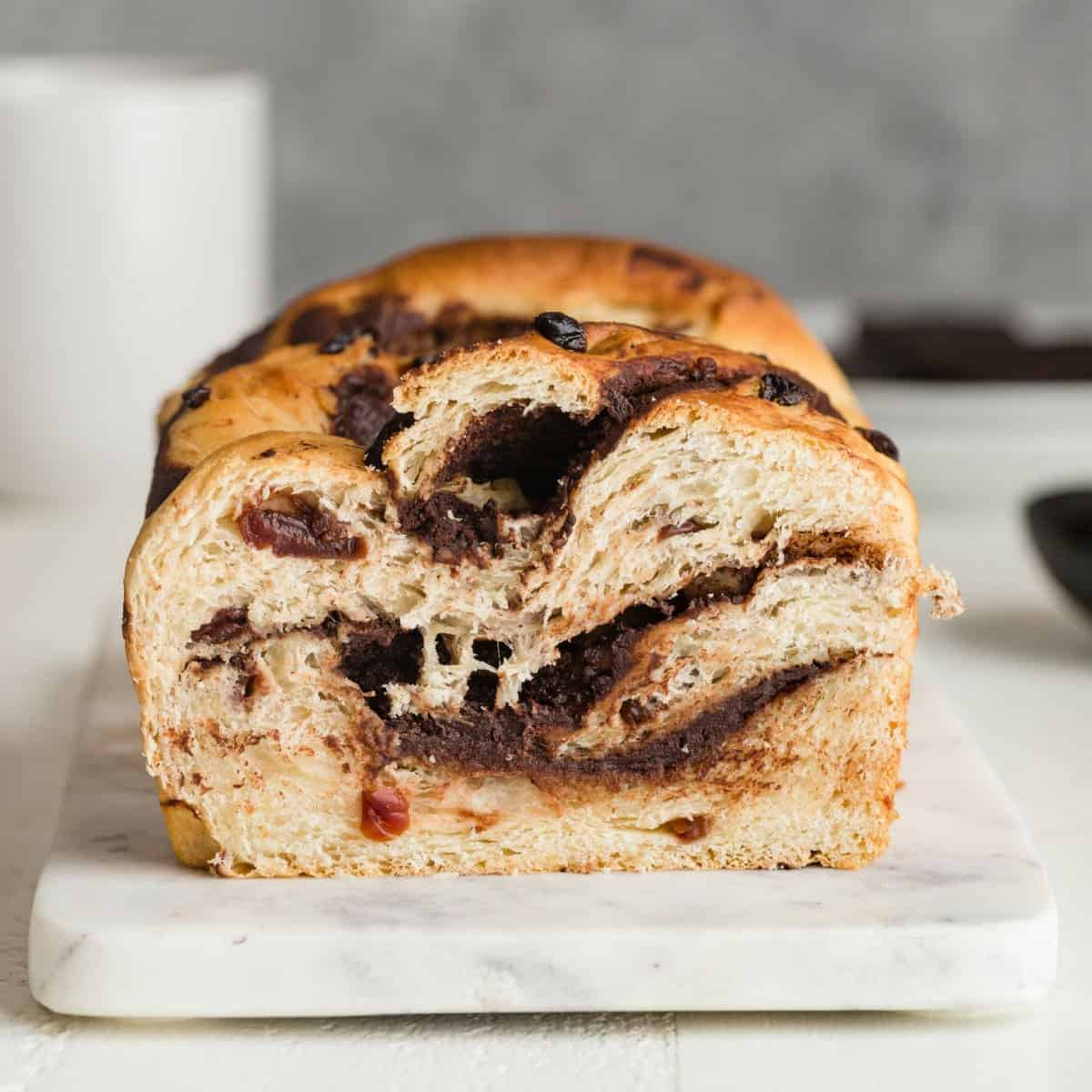 front view of chocolate swirl bread with cherries