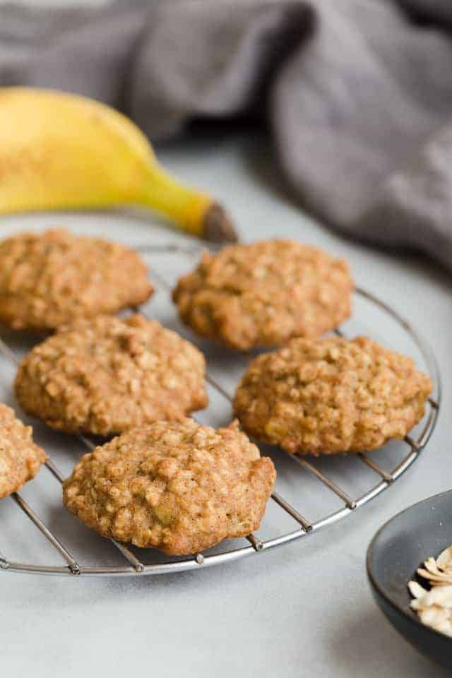 banana oatmeal cookies on a round wire cooling rack.