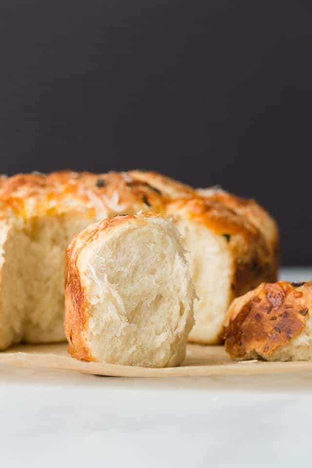 Side view of a fluffy Cheesy Pull Apart Roll with Garlic