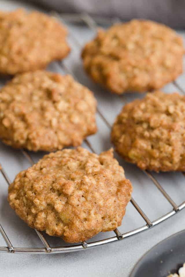 Close view of oatmeal banana cookies on wire rack.