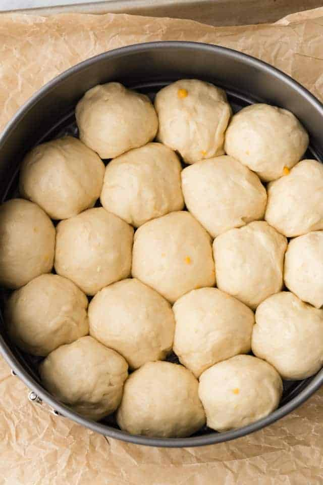 yeast dough balls in round pan
