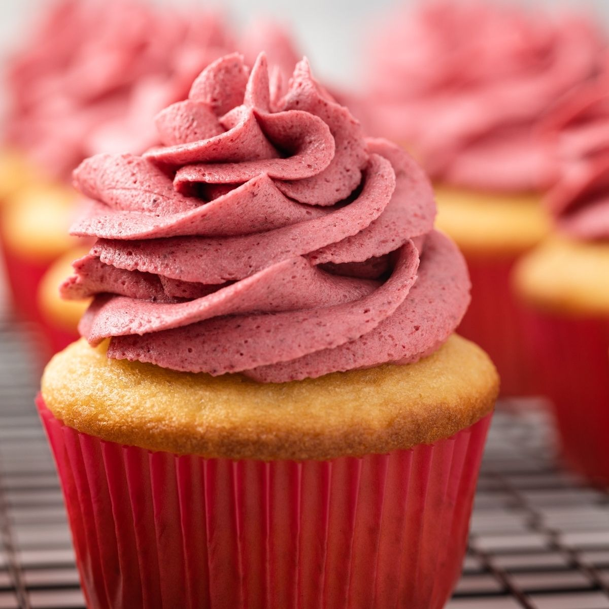 overhead view of raspberry frosting in a mixing bowl