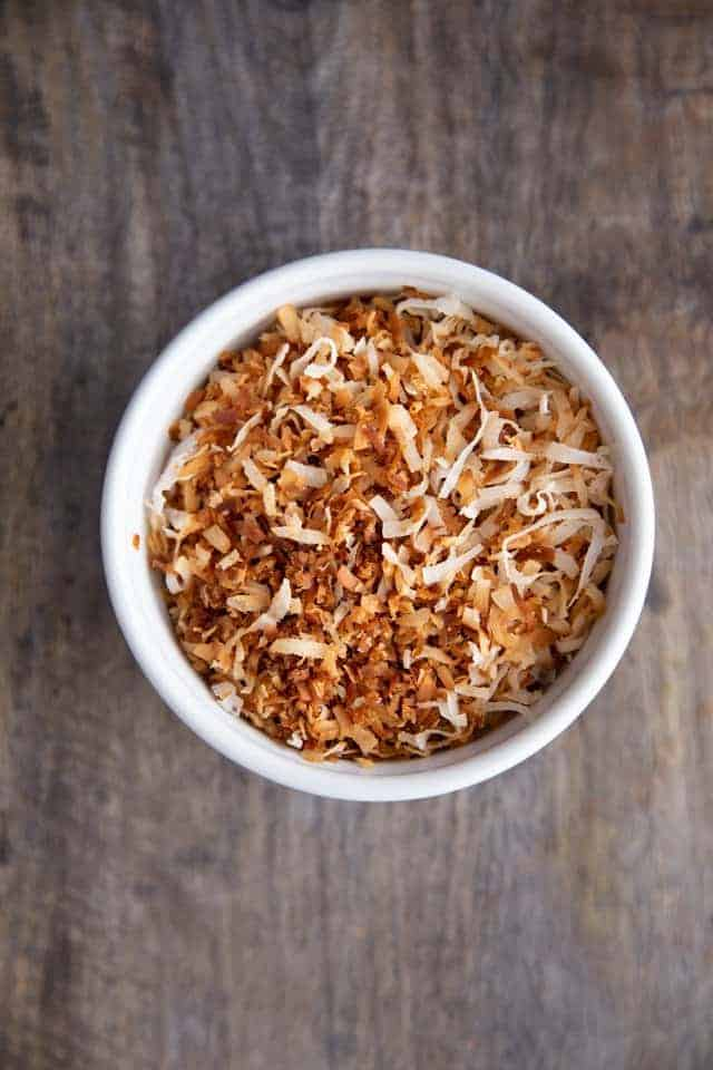 stovetop toasted coconut in a white bowl