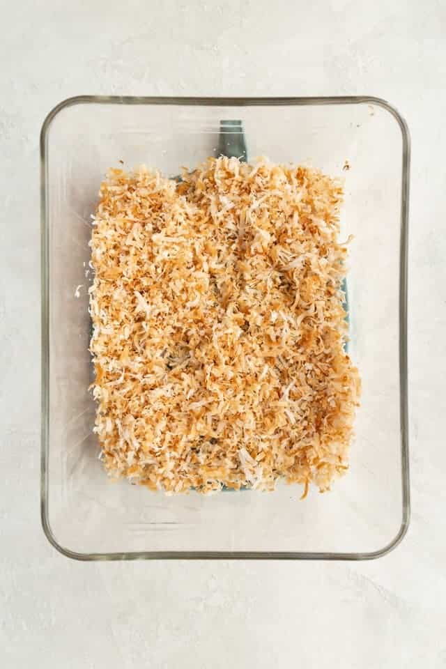 toasted coconut in a glass dish